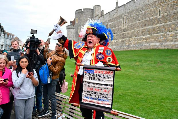 A man dressed as a town crier outside Windsor Castle in Berkshire following the news of the birth of the Duke and Duchess of Sussex's new baby boy. Dominic Lipinski/PA Wire