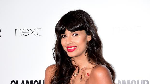 Jameela Jamil wants designers to make their sizes bigger (PA)