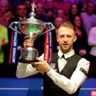 Judd Trump celebrates with the trophy after winning the 2019 Betfred World Championship at The Crucible, Sheffield. Richard Sellers/PA Wire