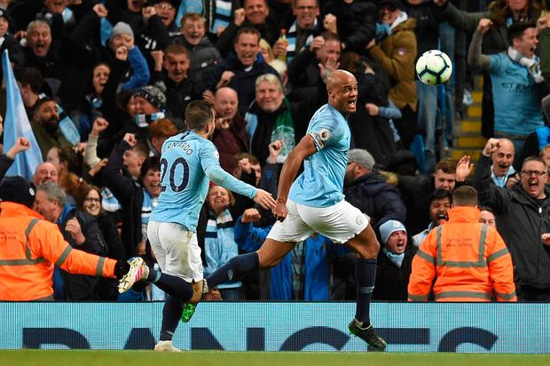 Manchester City's Belgian defender Vincent Kompany (R) celebrates scoring the opening goal during the English Premier League football match between Manchester City and Leicester City at the Etihad Stadium in Manchester, north west England, on May 6, 2019. OLI SCARFF/AFP/Getty Images