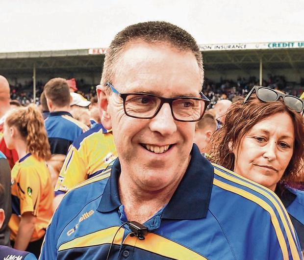 Clare joint-manger Gerry O'Connor is congratulated by supporters following the Banner's Munster SHC win over Tipp in Thurles last summer. Photo: David Fitzgerald/Sportsfile