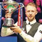 Judd Trump celebrates after winning the 2019 Betfred World Championship. Photo: Richard Sellers/PA Wire