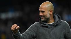 Manchester City's Spanish manager Pep Guardiola toasts a win against Leicester that edges his side to within touching distance of the Premier League title