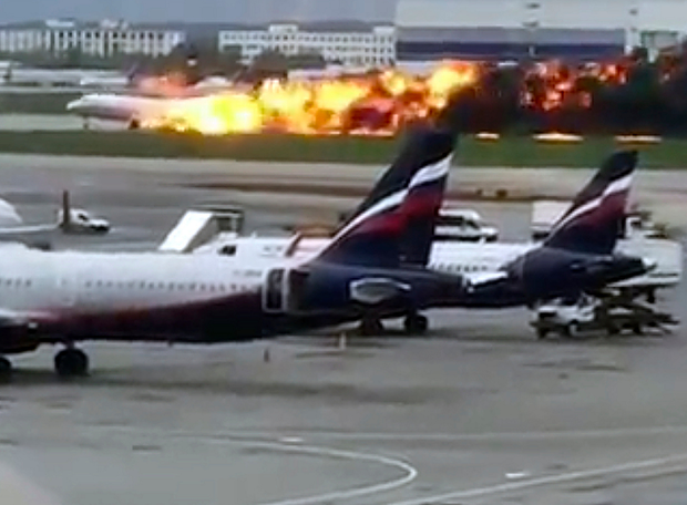 Fireball: The Aeroflot SSJ-100 aircraft on fire during an emergency landing in Sheremetyevo airport in Moscow. Photo: AP
