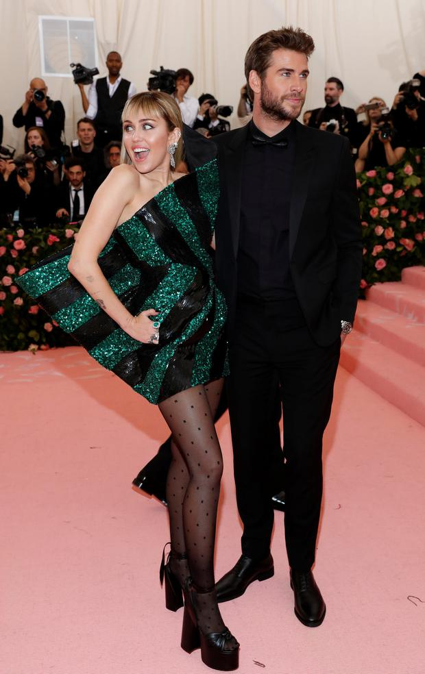 Metropolitan Museum of Art Costume Institute Gala - Met Gala - Camp: Notes on Fashion- Arrivals - New York City, U.S. – May 6, 2019 - Miley Cyrus and Liam Hemsworth. REUTERS/Andrew Kelly