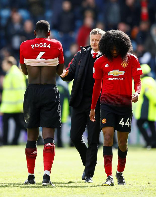 Manchester United's Paul Pogba and Tahith Chong look dejected after Huddersfield draw