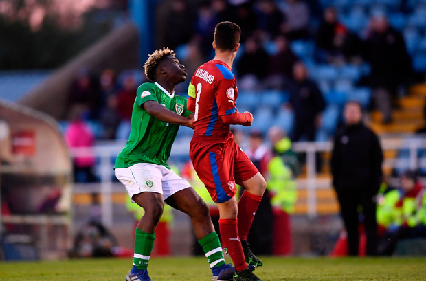 Festy Ebosele of Republic of Ireland comes together with Jan Hellebrand of Czech Republic for which he received a yellow card, his second of the game, and subsequent red card