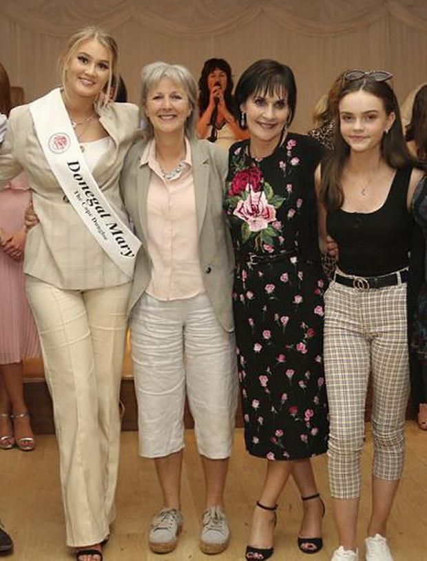 Enya (third left) at hte Mary From Dungloe selection event, where niece Hannah O'Donnell (left) was chosen. PIC: Eoin McGarvey