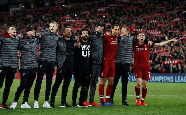 Liverpool's Andrew Robertson, Adam Lallana, Mohamed Salah, manager Juergen Klopp, Virgil van Dijk and James Milner celebrate in front of their fans after the match REUTERS/Phil Noble