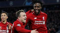 Divock Origi is congratulated by his Liverpool team-mate Xherdan Shaqiri (left) after scoring his team's fourth goal to seal their place in the Champions League final thanks to a 4-0 (4-3 on aggregate) win over Barcelona