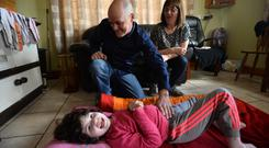 All smiles: Declan and Marie Ronan with their six-year-old daughter Tina. Photo: Ray Ryan