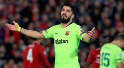 Barcelona's Luis Suarez looks dejected during the UEFA Champions League Semi Final, second leg match at Anfield, Liverpool. Photo credit: Peter Byrne/PA Wire.