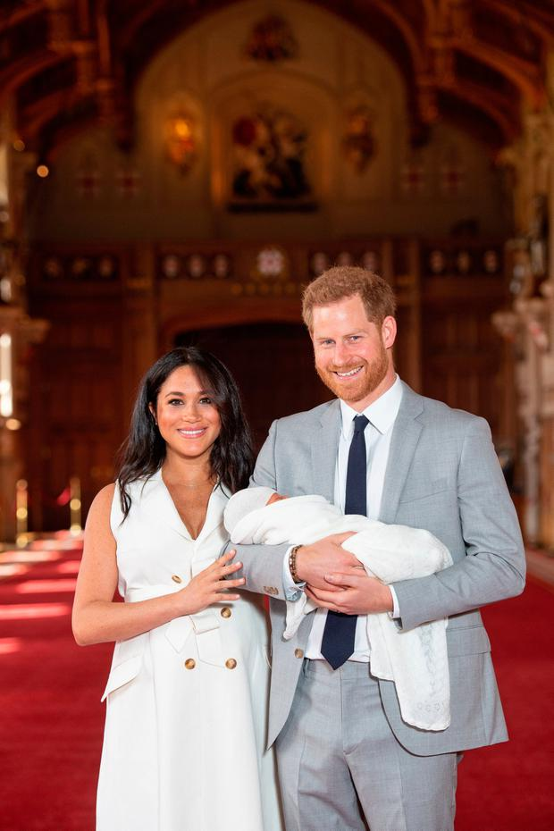 The Duke and Duchess of Sussex with their baby son, who was born on Monday morning, during a photocall in St George's Hall at Windsor Castle in Berkshire. Picture: Dominic Lipinski/PA Wire