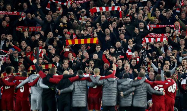 Liverpool players and fans celebrate after the match. Photo: Action Images via Reuters