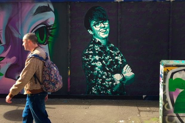 Threats: A man walks past a mural in tribute to murdered journalist Lyra McKee in Belfast. Photo: David Young/PA Wire