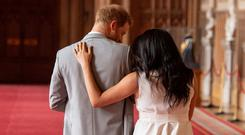 Britain's Prince Harry and Meghan, Duchess of Sussex walk away with their baby son, who was born on Monday morning, during a photocall in St George's Hall at Windsor Castle. Photo: Dominic Lipinski/Pool via REUTERS