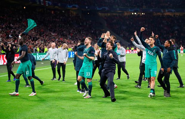 Tottenham Hotspur manager Mauricio Pochettino (centre) and his squad celebrate with fans after the final whistle. Photo: Adam Davy/PA Wire