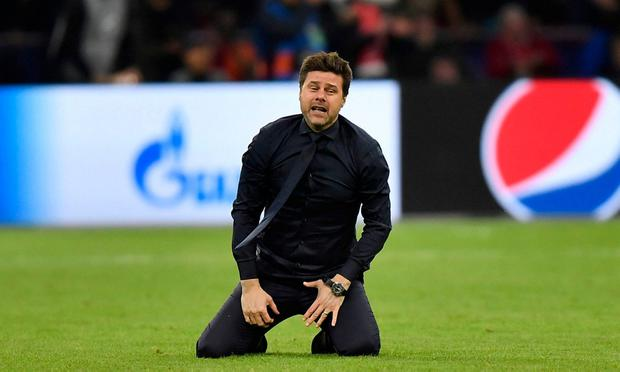 Pure joy: Spurs boss Mauricio Pochettino falls to his knees after last night's game. AP Photo/Martin Meissner