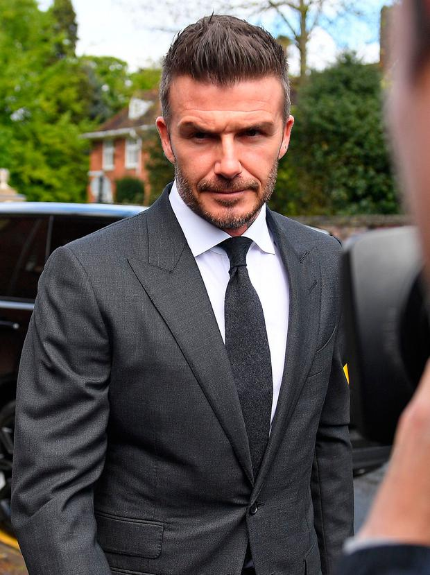 Former England international footballer David Beckham arrives at Bromley Magistrates Court in Bromley, south-east of London on May 9, 2019, where his case of driving whilst using a mobile phone is being held. (Photo by Daniel LEAL-OLIVAS / AFP)