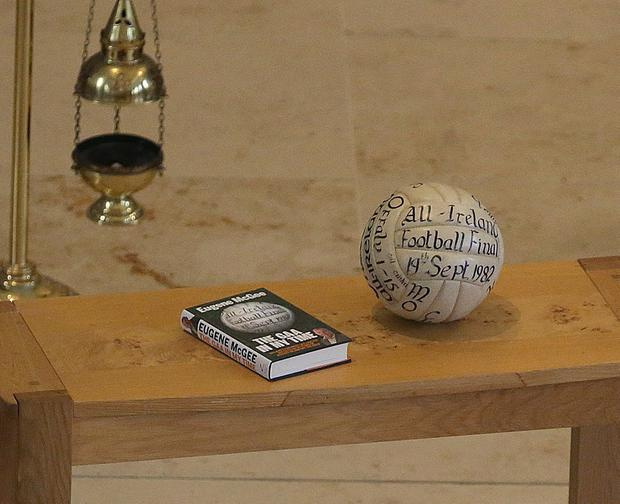 9/5/2019, One of Eugene's books and the football from the 1982 All Ireland football final at the funeral of Eugene McGee at St Mel's Cathedral in Longford. Picture credit; Damien Eagers / INM