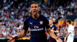 Pierre-Emerick Aubameyang celebrates scoring his side's first goal during their victory over Valencia. Photo: Nick Potts/PA Wire