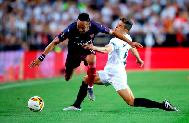 Arsenal's Pierre-Emerick Aubameyang (left) battles for control of the ball with Valencia's Armando Gabriel. Photo: Nick Potts/PA Wire