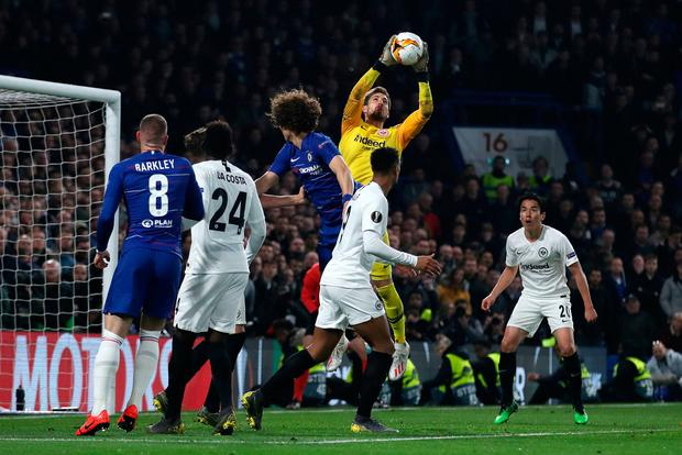 Frankfurt's Kevin Trapp jumps to make a save. Photo: Tim Goode/PA Wire