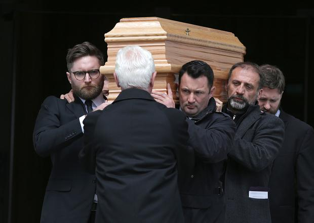 The coffin is carried from the cathedral. Photos: Damien Eagers