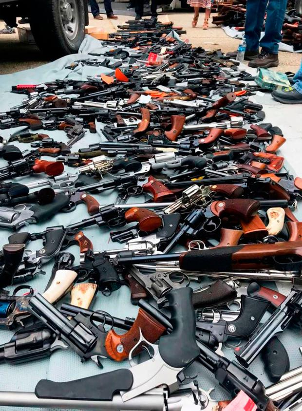 More than 1,000 handguns and rifles seized in a raid on a mansion in the exclusive Holmby Hills neighborhood of Los Angeles. Photo: HO / Los Angeles Police Department / AFP