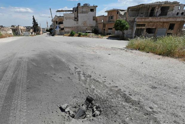 Picture shows part of a rocket which struck a street following reported shelling on the town of Khan Sheikhun in the southern countryside of the rebel-held Idlib province. Photo: OMAR HAJ KADOUR/AFP/Getty Images