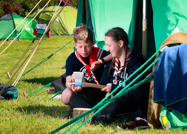 Mya O'Hara gives her brother Daniel a safety talk on wood craft during the 73rd Scout Troop camping weekend at Portlick Scout Campsite in Westmeath. Picture:Frank McGrath