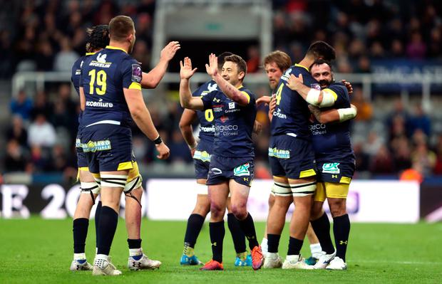 ASM Clermont Auvergne's Greig Laidlaw (centre) and team-mates celebrate victory at the final whistle of the Challenge Cup Final at St James' Park, Newcastle.