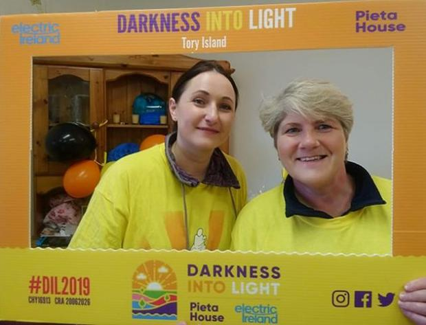 Two participants pose for the Darkness Into Light on Tory Island, Donegal Pic: Bernie McNulty