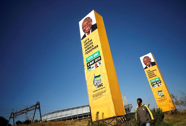 A man walks past election billboards of President Cyril Ramaphosa's ruling African National Congress (ANC) party in Soweto township near Johannesburg, South Africa, May 11, 2019. REUTERS/Mike Hutchings