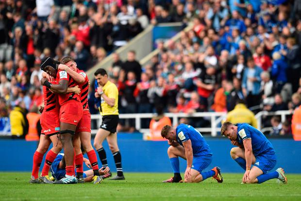 Players react on the final whistle in the European Rugby Champions Cup final match between Leinster and Saracens at St James Park stadium in Newcastle-upon-Tyne, north east England on May 11, 2019. (Photo by Glyn KIRK / AFP)GLYN KIRK/AFP/Getty Images