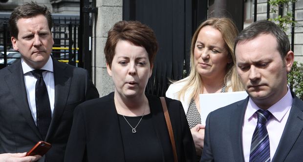 Ruth Morrissey and her husband Paul speak to the media on leaving the Four Courts after the High Court judgment that her incorrect cervical smear tests were the result of negligence. Photo: Collins Courts