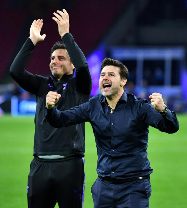 Success: Tottenham Hotspur coach Miguel D'Agostino and manager Mauricio Pochettino. Photo: REUTERS/Dylan Martinez