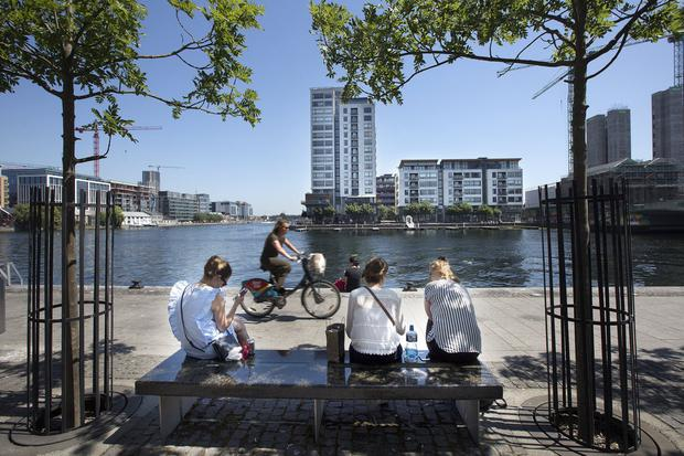 City amenity: Enjoying a lunch break in Dublin's Grand Canal Dock - but groups of teenagers visiting the area are causing concern. Photo: Tony Gavin