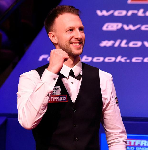 Judd Trump celebrates as he wins the 2019 Betfred World Snooker Championship final. Photo: Nathan Stirk/Getty Images