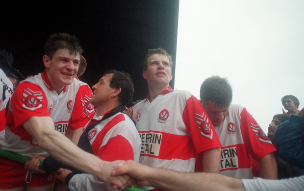 Enda Gormley is congratulated by a supporter after victory over Cork, as manager Eamonn Coleman and players Tony Scullion and Anthony Tohill, right, await the presentation in 1993