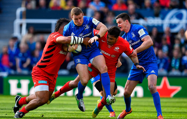 Seán Cronin of Leinster is tackled by Billy Vunipola and Brad Barritt of Saracens