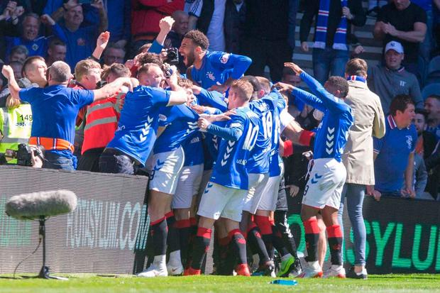 Rangers Scott Arfield (obscured) celebrates scoring his side's second goal