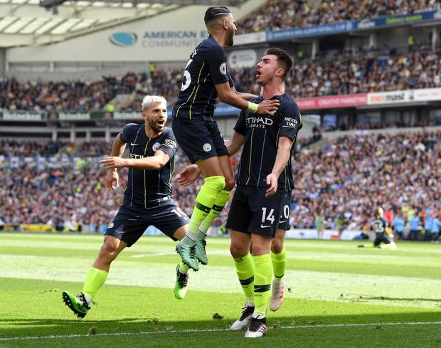 Aymeric Laporte of Manchester City celebrates with teammate Riyad Mahrez after scoring his team's second goal during the Premier League match between Brighton & Hove Albion and Manchester City