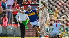 John McGrath of Tipperary celebrates after scoring his side's second goal past Cork goalkeeper Anthony Nash during the Munster GAA Hurling Senior Championship Round 1 match between Cork and Tipperary at Pairc Ui Chaoimh in Cork. Photo by Diarmuid Greene/Sportsfile