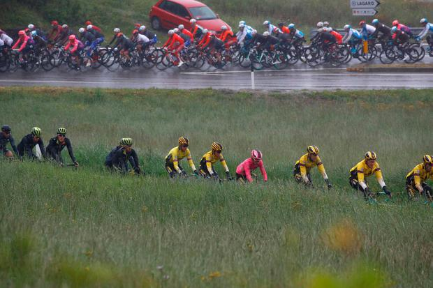 Riders compete during the second stage of the 2019 Giro d'Italia, the cycling Tour of Italy, on May 12, 2019 near Bologna. - Giro d'Italia's stage 2 consists in a 205 km route between Bologna and Fucecchio. Photo Credit: LUK BENIES/AFP/Getty Images