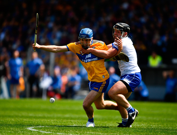 Shane ODonnell of Clare in action against Noel Connors of Waterford. Photo by Ray McManus/Sportsfile