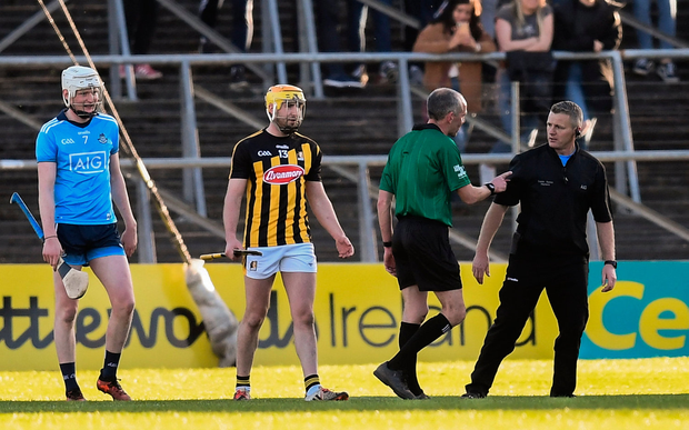Referee Cathal McAllister ushers Greg Kennedy from the pitch after the Dublin selector caught a short TJ Reid free intended for Kilkenny's Billy Ryan. Photo by Stephen McCarthy/Sportsfile