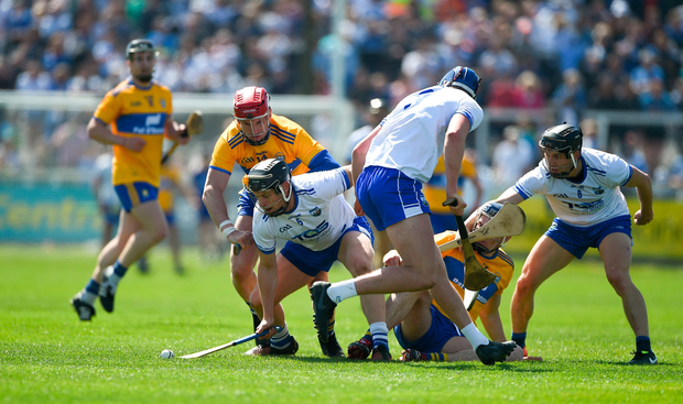 Philip Mahony of Waterford in action against John Conlon of Clare. Photo by Daire Brennan/Sportsfile