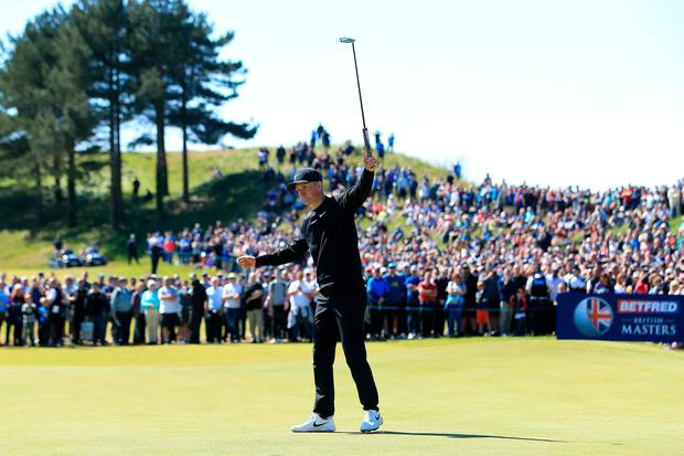 Marcus Kinhult of Sweden celebrates holing a putt for victory on the 18th green on the final day of the British Masters. Photo: Andrew Redington/Getty Images