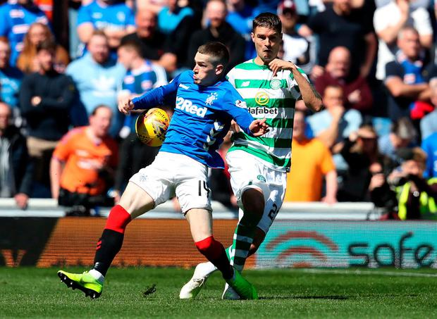 Rangers Ryan Kent (left) challenges Celtic's Mikael Lustig. Photo: Andrew Milligan/PA Wire